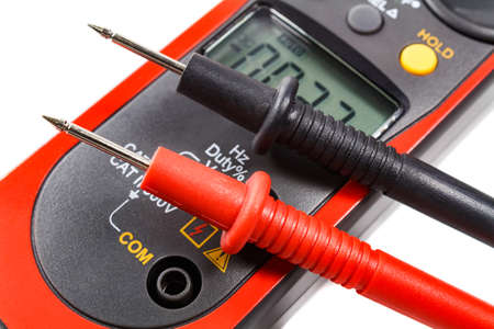 probes: Digital clamp multimeter with probes on a white background
