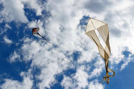 Flying kite on a blue sky background Stock Photo