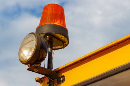 hydraulic lift: Orange flashing beacon on a forklift truck closeup Stock Photo