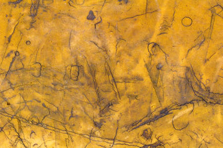 Yellow construction foam with damaged and dirty surface texture closeup. Abstract background