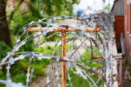 wire fence: Barbed wire on a concrete fence. Fenced and guarded territory Stock Photo