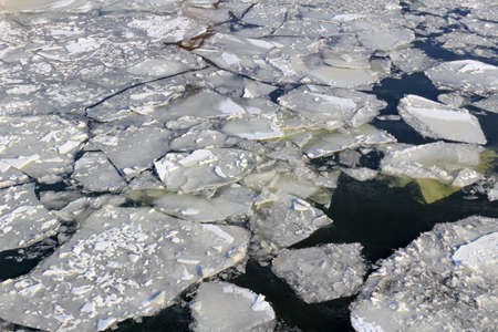 Broken ice on the surface of the river in winter. Ice floes texture Standard-Bild