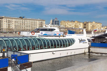 Moscow, Russia - March 25, 2018: Pleasure boats at the pier on the Moskva river Editorial