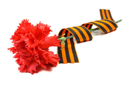 Red carnations with St. George's ribbon isolated on white background. May 9 day of victory in the great Patriotic war of 1941-1945 Banco de Imagens - 99911854