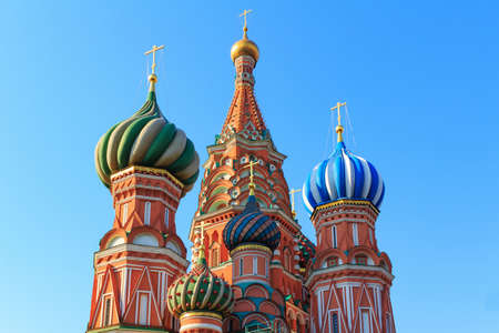 Dome of St. Basils Cathedral on a blue sky background. Sunny morning in Moscow