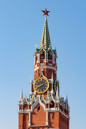 Spasskaya tower on Red square in Moscow on a blue sky background Stock Photo