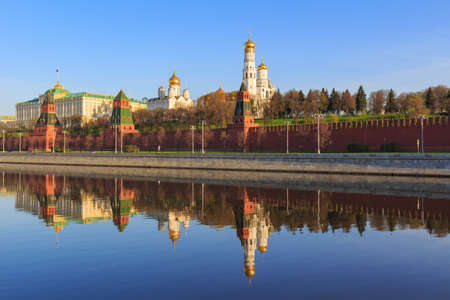 Reflections of Moscow Kremlin buildings on the water surface of Moskva river in spring sunny morning