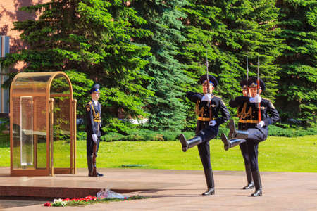 Moscow, Russia - May 27, 2018: Ceremony of changing guard of honor at eternal flame in Alexander garden near Moscow Kremlin in sunny evening