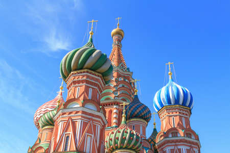Domes of St. Basil's Cathedral on Red square against blue sky on a sunny summer morning