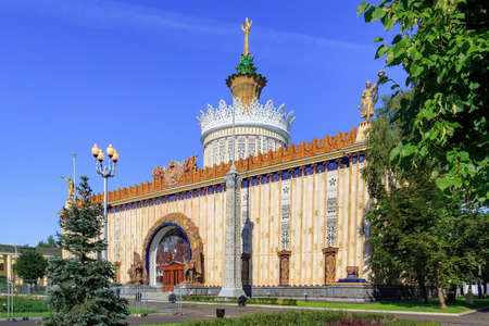 Moscow, Russia - August 01, 2018: Facade of pavilion Ukrainian SSR on Exhibition of Achievements of National Economy (VDNH) in Moscow against green trees and blue sky on a sunny summer morning Editorial