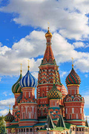 Moscow, Russia - September 30, 2018: Domes of St. Basil Cathedral on a background of blue sky with white clouds 写真素材 - 120754882