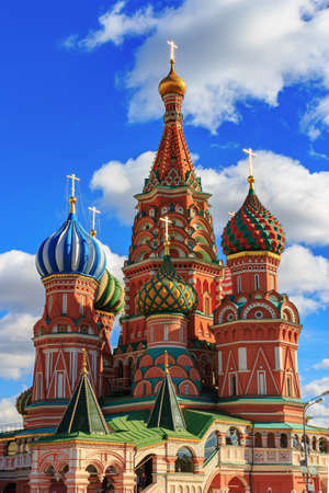 Moscow, Russia - September 30, 2018: Domes of St. Basil Cathedral on a background of blue sky with white clouds