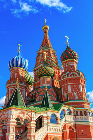 Moscow, Russia - September 30, 2018: St. Basil Cathedral onions on a background of blue sky with white clouds 写真素材 - 120754880