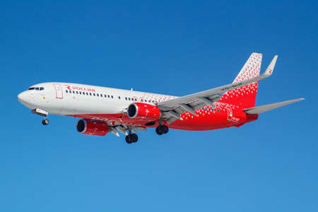 Moscow, Russia - March 26, 2019: Aircraft Boeing 737-8GJ(WL) VQ-BUF of Rossiya - Russian Airlines against blue sky in sunny morning going to landing at Vnukovo international airport in Moscow