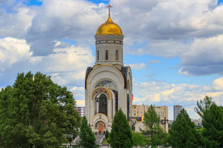 Moscow, Russia - June 09, 2018: Church of Great Martyr George Victorious on Poklonnaya Hill in Moscow on a background of blue sky with white clouds in sunny day