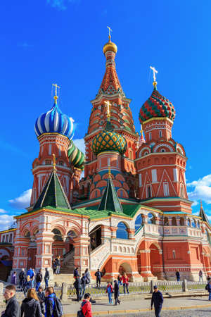 Moscow, Russia - September 30, 2018: Architecture of St. Basil Cathedral in sunny day on a background of blue sky with white clouds