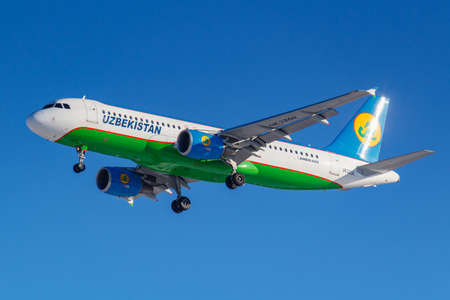 Moscow, Russia - March 26, 2019: Aircraft Airbus A320-214 UK32011 of Uzbekistan Airways against blue sky in sunny morning going to landing at Vnukovo international airport in Moscow