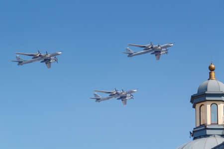 Moscow, Russia - May 07, 2019: Turboprop strategic bomber-missile carrier TU-95MS in the blue sky over Red Square. Aviation part of Victory parade 2019 in Moscow Imagens - 122972558