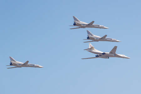 Moscow, Russia - May 07, 2019: Supersonic strategic bomber-missile carrier TU-160M accompanied by long-range supersonic missile carrier-bomber TU-22M3. Aviation part of Victory parade 2019 in Moscow
