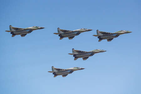 Moscow, Russia - May 07, 2019: Fourth generation multipurpose fighter MiG-29SMT in the blue sky over Red Square. Aviation part of Victory parade 2019 in Moscow