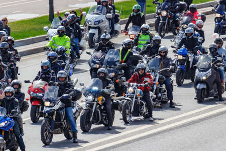 Moscow, Russia - May 04, 2019: Bikers in column ride along Frunzenskaya embankment of Moskva river in Moscow. Moto festival MosMotoFest 2019. Official opening of motorcycle season