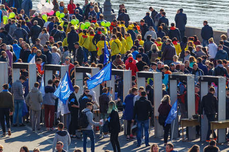 Moscow, Russia - May 01, 2019: People pass through framework of metal detectors at May Day demonstration in Moscow