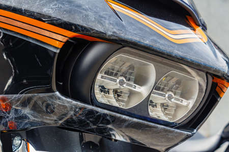 Moscow, Russia - May 04, 2019: Headlights and windproof shield with airbrushing of Harley Davidson motorcycle closeup. Moto festival MosMotoFest 2019 Editorial