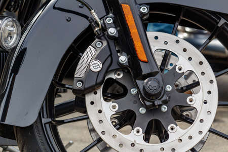 Moscow, Russia - May 04, 2019: Front wheel of Harley Davidson motorcycle closeup. Moto festival MosMotoFest 2019