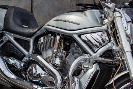 Moscow, Russia - May 04, 2019: Chrome engine with exhaust system pipes and glossy silver fuel tank with emblem of Harley Davidson motorcycles closeup. Moto festival MosMotoFest 2019 Editorial