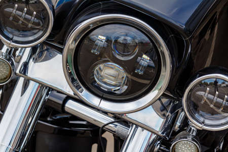 Moscow, Russia - May 04, 2019: Chromed headlights with direction indicators of Harley Davidson motorcycle closeup. Moto festival MosMotoFest 2019