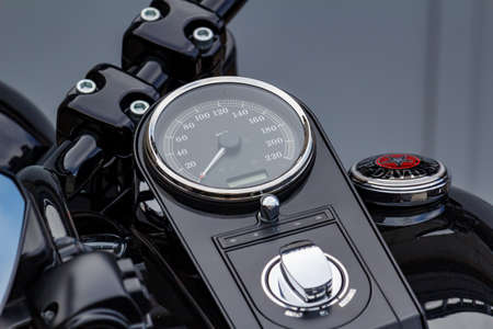 Moscow, Russia - May 04, 2019: Speed indicator with odometer and ignition switch of Harley Davidson motorcycle closeup. Moto festival MosMotoFest 2019 Editorial