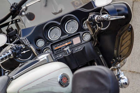 Moscow, Russia - May 04, 2019: Dashboard with indicators and multimedia system of Harley Davidson motorcycle closeup. Moto festival MosMotoFest 2019 Editorial
