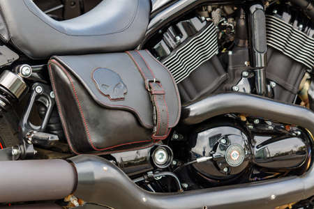 Moscow, Russia - May 04, 2019: Leather travel bag on the side of Harley Davidson motorcycle closeup. Moto festival MosMotoFest 2019 Editorial