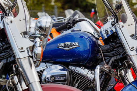 Moscow, Russia - May 04, 2019: Blue fuel tank of Harley Davidson motorcycle with emblem and chrome engine closeup. Moto festival MosMotoFest 2019