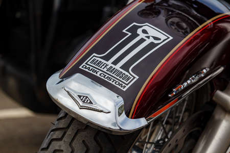 Moscow, Russia - May 04, 2019: Front fender of Harley Davidson motorcycle with Dark Custom emblem closeup. Moto festival MosMotoFest 2019