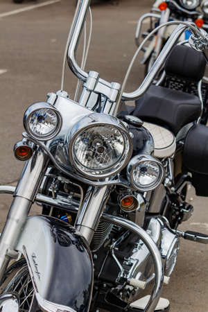 Moscow, Russia - May 04, 2019: Chromed Harley Davidson motorcycle in a parking at sunny day. Moto festival MosMotoFest 2019 Editorial