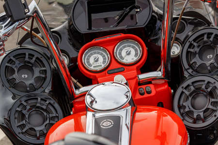 Moscow, Russia - May 04, 2019: Bright orange painted Harley Davidson motorcycle with a power speakers of multimedia system closeup. Moto festival MosMotoFest 2019