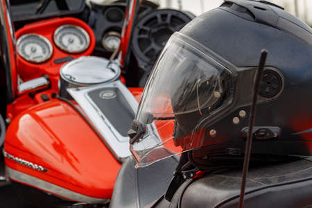 Moscow, Russia - May 04, 2019: Motorcycle helmet closeup on the seat of motorcycle. Moto festival MosMotoFest 2019 Editorial