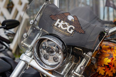 Moscow, Russia - May 04, 2019: Emblem of Harley Owners Group on transparent windproof shield of Harley Davidson motorcycle. Moto festival MosMotoFest 2019