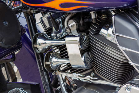 Moscow, Russia - May 04, 2019: Chromed air horns on engine background of Harley Davidson motorcycle closeup. Moto festival MosMotoFest 2019