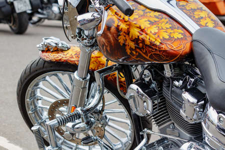 Moscow, Russia - May 04, 2019: Custom chromed and painted with airbrushing Harley Davidson motorcycle closeup. Moto festival MosMotoFest 2019