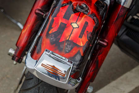 Moscow, Russia - May 04, 2019: Front fender with airbrushed Harley Davidson motorcycles emblem closeup. Moto festival MosMotoFest 2019 Editorial