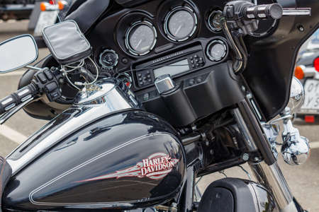 Moscow, Russia - May 04, 2019: Dashboard with indicators and multimedia system of Harley Davidson motorcycle. Moto festival MosMotoFest 2019