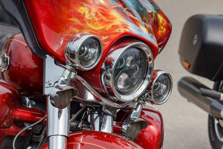 Moscow, Russia - May 04, 2019: Chrome headlights with direction indicators of Harley Davidson motorcycle closeup. Moto festival MosMotoFest 2019