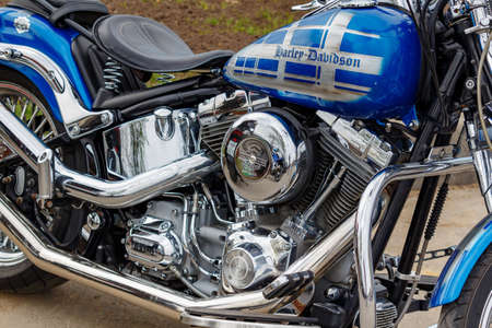 Moscow, Russia - May 04, 2019: Glossy blue fuel tank with airbrushing and chrome engine of Harley Davidson motorcycle. Moto festival MosMotoFest 2019 Editorial