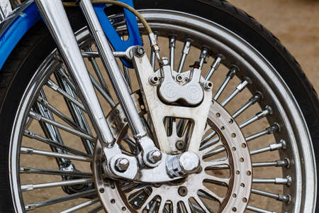 Moscow, Russia - May 04, 2019: Front wheel with disc brake system of Harley Davidson motorcycle closeup. Moto festival MosMotoFest 2019 Editorial