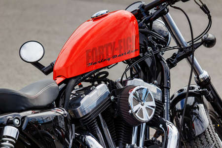 Moscow, Russia - May 04, 2019: Forty Eight Harley Davidson motorcycle with bright orange fuel tank closeup. Moto festival MosMotoFest 2019 Editorial