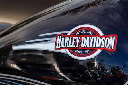 Moscow, Russia - May 04, 2019: Emblem of Harley Davidson motorcycles on the glossy black fuel tank closeup. Moto festival MosMotoFest 2019