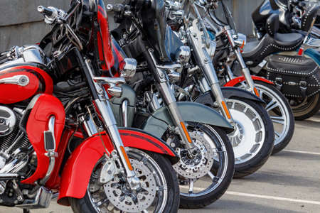 Moscow, Russia - May 04, 2019: Front wheels of Harley Davidson motorcycles on a parking. Moto festival MosMotoFest 2019 Editorial