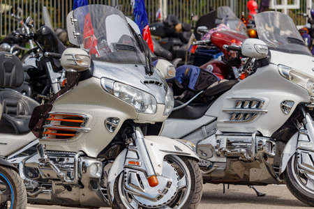Moscow, Russia - May 04, 2019: Two silvery tourist motorcycles Honda Gold Wing in the parking closeup. Moto festival MosMotoFest 2019